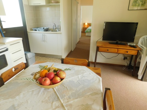 Lounge and passage area of cottage 23 - Seaside Cottages Fish Hoek