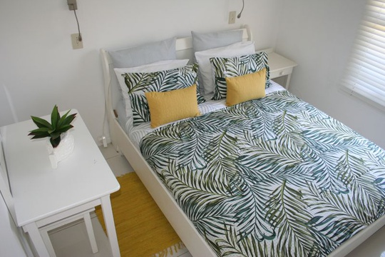 Main bedroom with double bed Cottage 31 Seaside Cottages Fish Hoek