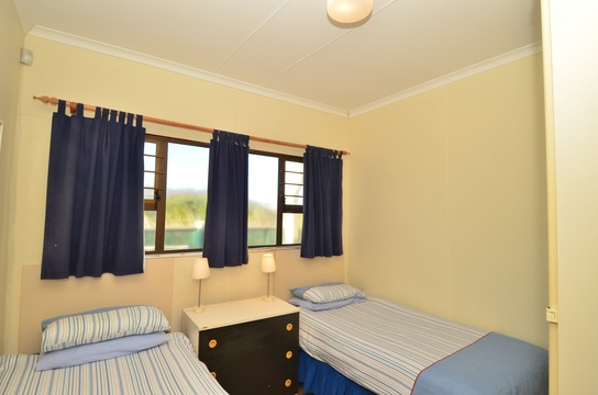 Main bedroom of cottage 72- Seaside Cottages Fish Hoek