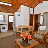 Lounge and kitchen area of cottage 43 - Seaside Cottages Fish Hoek