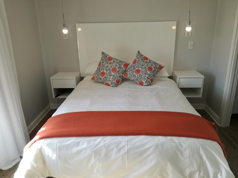 Main bedroom with double bed of Cottage 65 at Seaside Cottages Fish Hoek