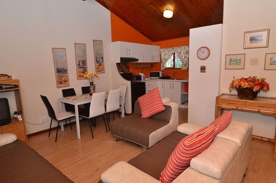 Lounge and dining area of Cottage 57, Seaside Cottages Fish Hoek