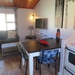 Lounge and dining area of Cottage 42 - Seaside Cottages Fish Hoek