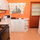 Kitchen area of Cottage 57, Washing machine and dish washer Seaside Cottages