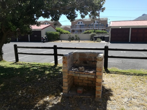 Braai area at the back of cottage 18 - Seaside Cottages Fish Hoek