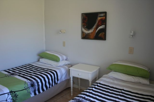 Main Bedroom (twin Beds) of Cottage 36 at Seaside Cottages Fish Hoek