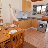 Kitchen and dining area of Cottage 26 - Seaside Cottages Fish Hoek