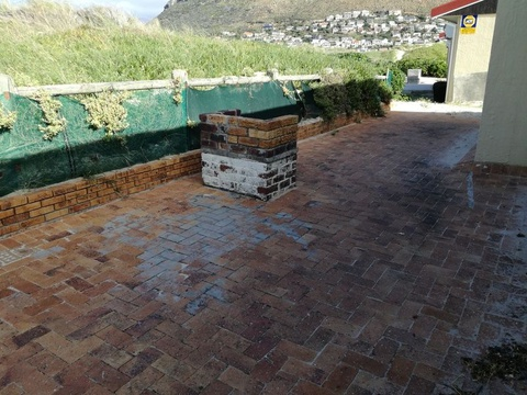 Private braai/BBQ area at rear of Cottage 65 Seaside Cottages Fish Hoek