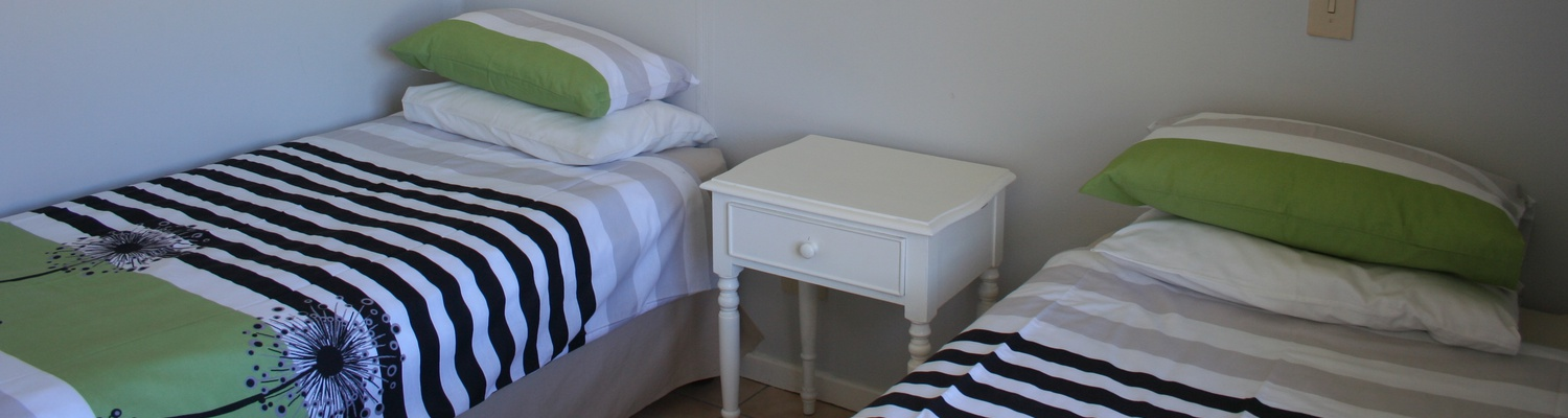 Main Bedrooom, twin beds of Cottage 36 Seaside Cottages Fish Hoek