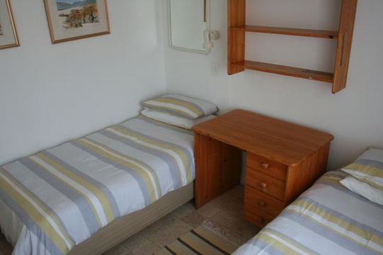 Main Bedroom of Cottage 44 with twin beds - Seaside Cottages Fish Hoek