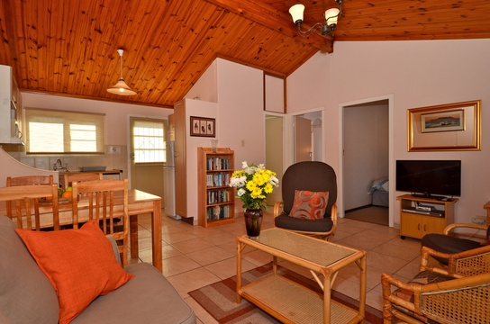 Lounge and dining area of cottage 39 - Seaside Cottages Fish Hoek